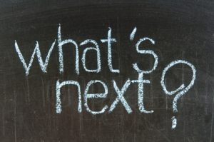 Chalk writing - What's next words written on chalkboard